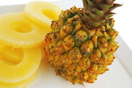 fresh raw pineapple sliced on white plate Standard-Bild