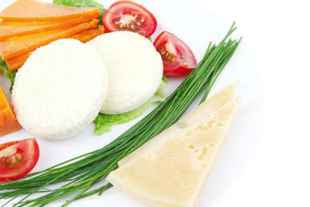 cheeseboard: french cheeses : delicatessen aged cheeses with soft feta chops served on white plate with slices isolated on white background