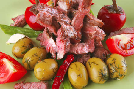 roast beef slices close up on dish over white photo
