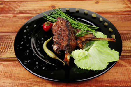 main course: barbecued ribs served with capers and chives photo