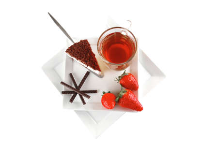 cake, tea, and strawberry served on white plate photo
