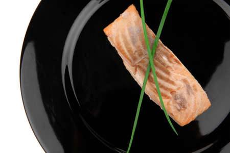 sea food : roasted pink salmon fillet with chinese onion, on black dish isolated over white background Stock Photo - 10405310