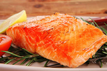 grilled salmon: food: grilled salmon on big glass plate on wooden table