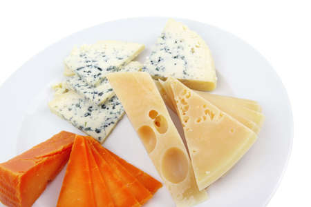old blue stilton roquefort with orange cheddar and yellow parmesan and slices on plate with isolated over white background photo
