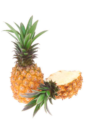 fruit diet - whole and half pineapples isolated over white background photo