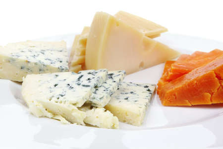 aged parmesan roquefort and gruyere chops delicatessen cheeses and slices on plate isolated over white background photo