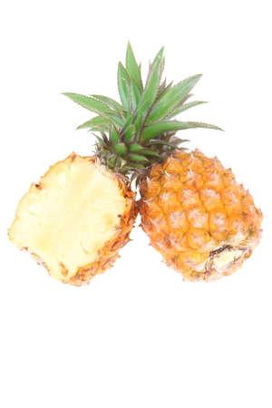 exotic fruit - fresh raw pineapple whole and half isolated over white background photo