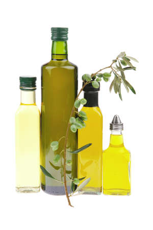 cooking oil: green raw olives on a branch with oil Stock Photo