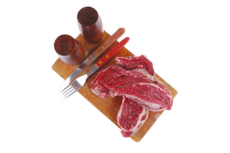 pepper castor: raw fillet mignon on cutting board prepared for roasting