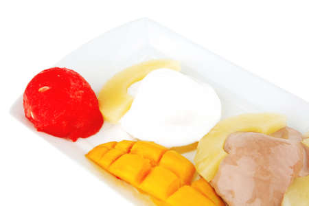 brylle: fresh tropical fruits and ice cream on white