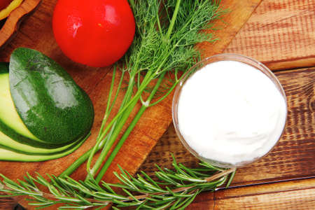 vegetables and sour cream on wooden table Stock Photo - 10590894