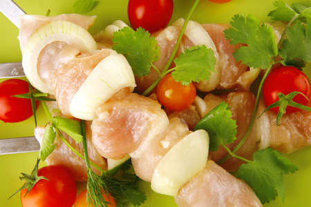 served raw chicken kebabs with tomatoes and peppers Stock Photo - 10620412