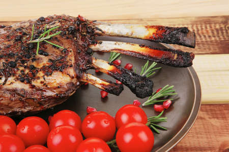 charbroiled: served charbroiled ribs on plate with vegetables