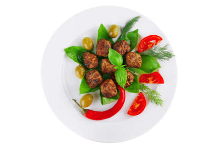 meat balls on basil leaf with olives and tomatoes photo