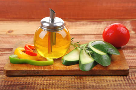 vegetables and oil prepared on wooden board photo