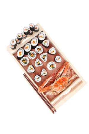 Maki Roll with Deep Fried Vegetables inside . on wooden plate with live crab . isolated over white background . Japanese Cuisine  Stock Photo - 10738099