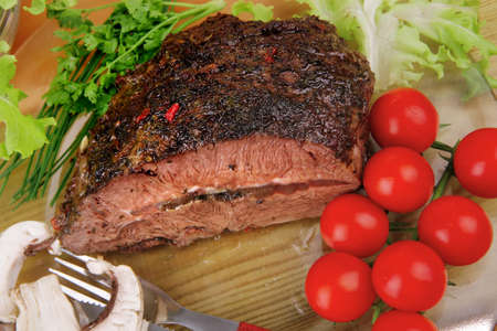 beef on transparent plate with salad bowl photo