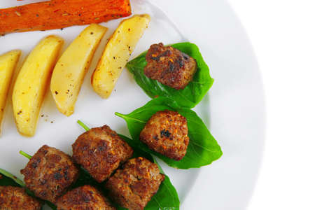 grilled beef meatballs with baked potatoes on white photo