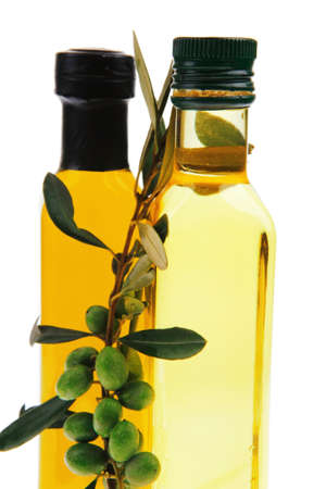 raw gold: green raw olives with gold oil on white background