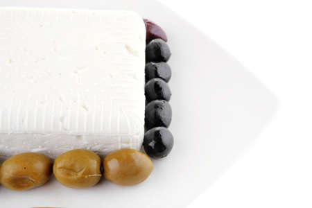 mediterranian: image of feta cube on plate with rare olives