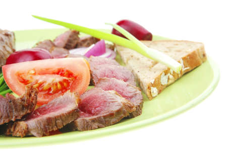 meat food : grilled fat meat served on green plate with tomatoes and sprouts isolated on white background Stock Photo - 10780843
