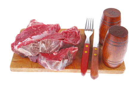 pepper castor: beef fillet on plate with cutlery served before cooking Stock Photo