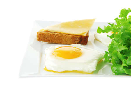 scrambled: green lettuce salad and fried eggs on white