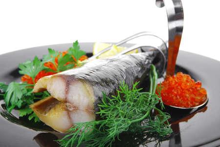cod fish: image of smoked mackerel on black plate with caviar