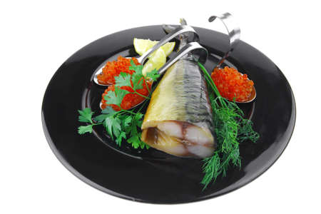 smoked fish with red caviar on black plate photo