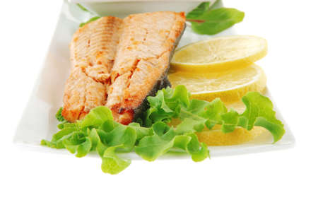 salmon steak on white plate with butter photo