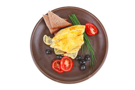 fish fillet with greek olives,tomatoes,chives and lemon on plate Stock Photo - 10852449