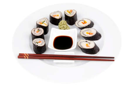 Japanese Cuisine : Sushi Maki Roll with Salmon and tuna inside . on white dish with sticks isolated over white background photo