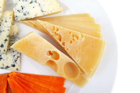 fresh aged french cheese parmesan roquefort and gruyere chops with slices on plate with isolated over white background photo