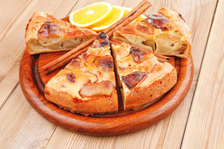 baked food : apple pie cuts on over table with cinnamon sticks and lemons photo