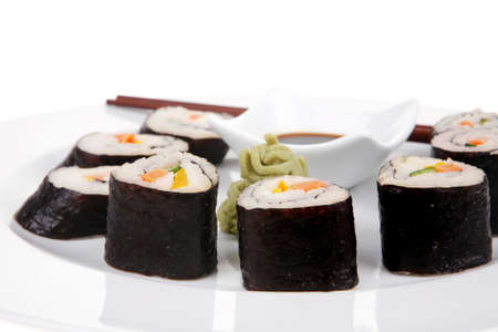 sake maki: Japanese Traditional Cuisine - California Roll with Salmon (sake), Cream Cheese and Tuna (maguro) . on white dish with sticks isolated over white background Stock Photo