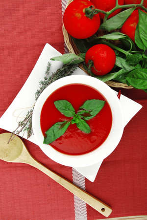 free photo: diet food : hot tomato soup with basil thyme and dry pepper in big bowl over red mat on wood table ready to eat