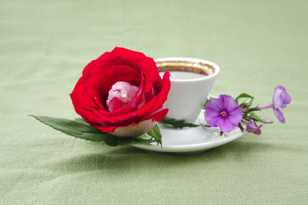 sweet breakfast : whipped cream cake with roses and hot black coffee photo