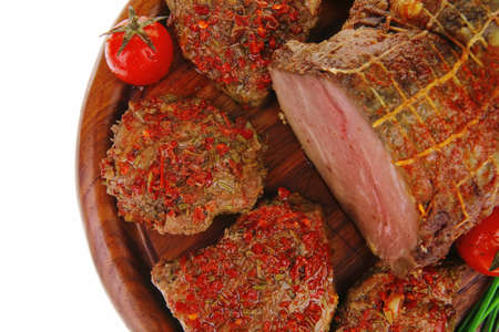 peppered: served peppered roast meat chops on wood Stock Photo