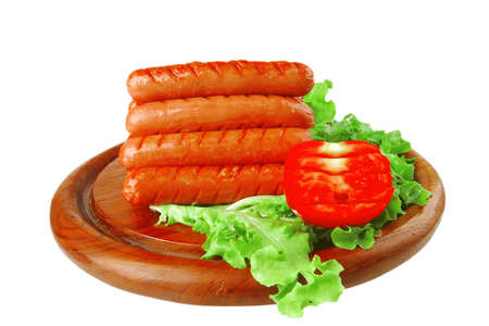 grilled beef red sausages on wooden plate photo