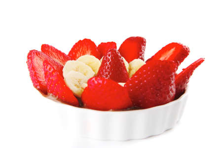 served fresh raw strawberries with slices on white photo