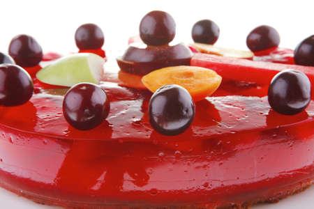 gelatine: image of cold red jelly cake with cherry and watermelon Stock Photo