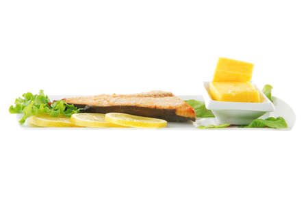 roast salmon fillet with butter on white plate photo