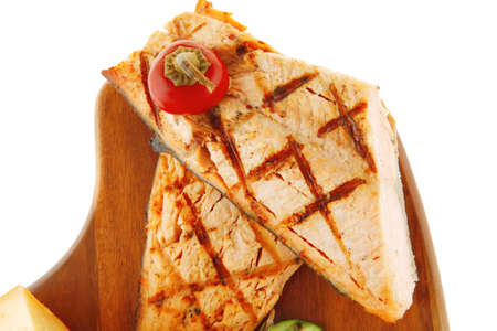 king salmon: grilled salmon fillet and delicious cheeses on wood