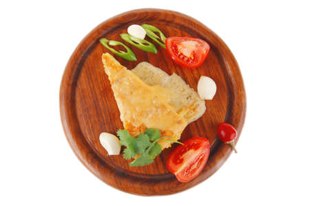 meatless: dairy food : cheese casserole piece over wood plate served with peppers , tomatoes and chives isolated over white background