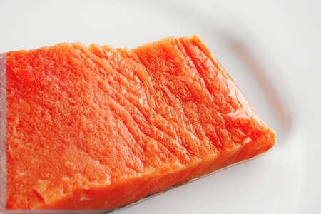 smoked fresh salmon piece on a big white dish photo