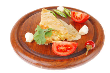 dairy food : vegetable cheese casserole slice on wooden plate served prepared with tomatoes  and garlic isolated over white background photo