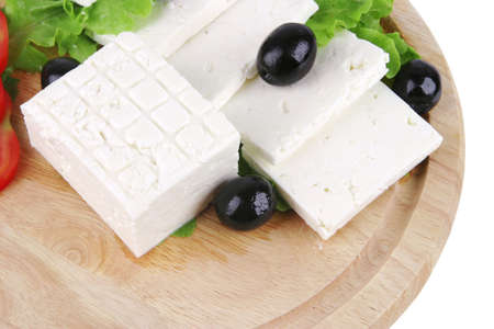 soft cheese with olives on wooden plate photo