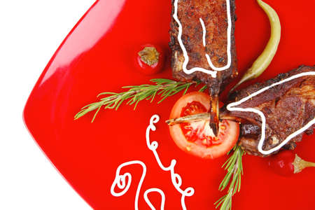 entree: served entree: ribs on red plate with hot peppers and tomatoes