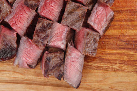 american meat : big rare roast steak on wood isolate on white background photo