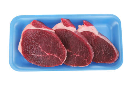fresh meat : raw uncooked fat lamb pork fillet mignon loin on blue tray isolated over white background photo